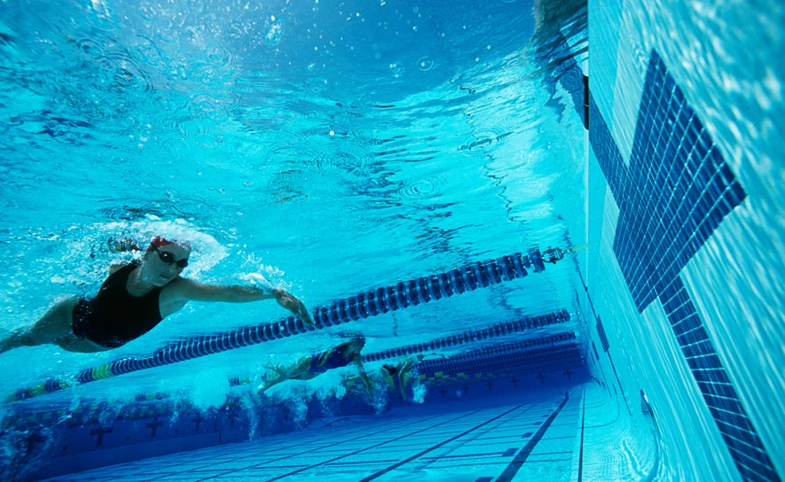 A an underwater look at a swimmer just off the wall