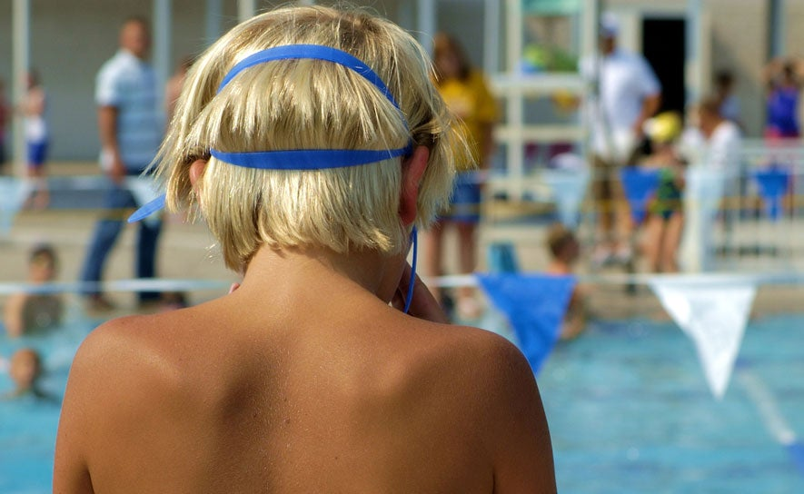 Swimmer with chlorine hair.