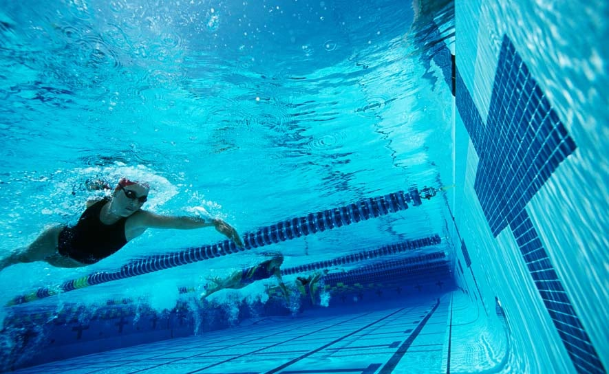 Underwater swimmer nearing the wall