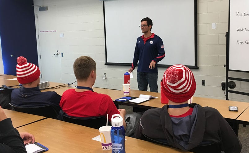 Justin Wright talks to swimmers at the 2018 National Select Camp.