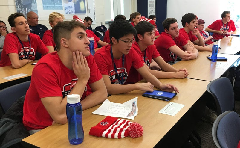 Swimmers at the 2018 National Select Camp listen to a presentation.