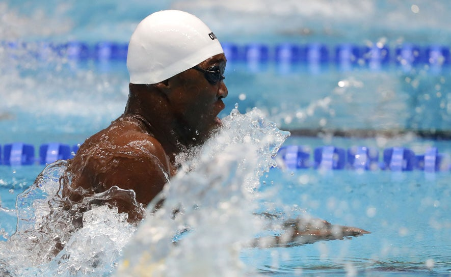 Reece Whitley competes in the 50m breaststroke during the FINA World Junior Championships
