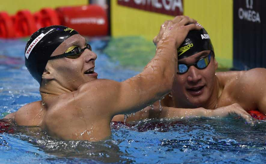 Caeleb Dressel and Nathan Adrian after the semifinals of the 100m free.
