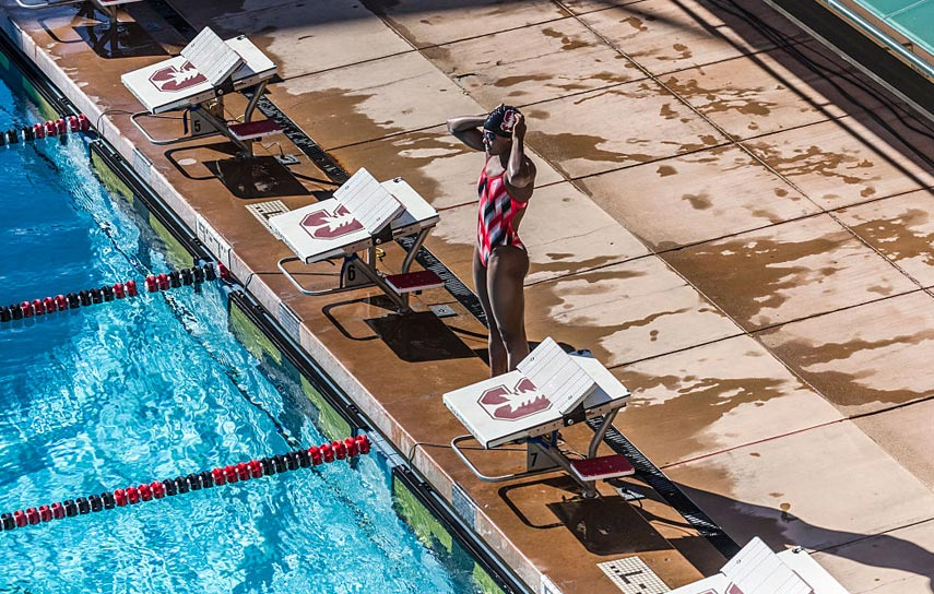 Simone Manuel stands by the starting block at a USC vs Stanford Meet