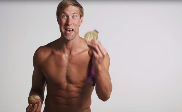 Matt Grevers with a muffin and a medal.