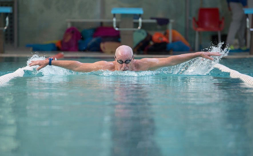 male swimmer with shaved head